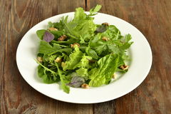 Salad with spinach, arugula, lettuce, herbs and nuts Stock Photos