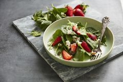 Green salad with feta and strawberries royalty free stock photo