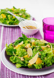 Salad with spinach, oranges and nuts.  Royalty Free Stock Photography
