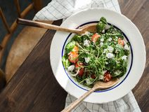 Salad of spinach, quinoa, onion and cherry tomatoes with feta cheese stock photography