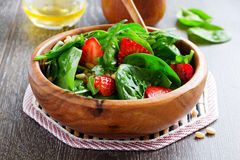 Salad with spinach and strawberries. Royalty Free Stock Image