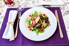 A salad in spring restaurant with violet napkins. Fresh salad in cafe colourfull meal. Horizontal photo. Flat. With mushrooms Royalty Free Stock Image