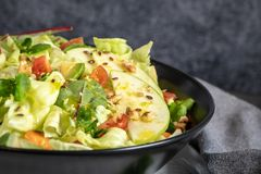 Salad. Spring vegetable salad. Fresh vegetable salad with tomato Stock Photos