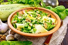 Salad with squash and sorrel in plate on dark board Royalty Free Stock Image