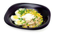 Salad of squid meat, eggs, canning corn with mayon Royalty Free Stock Photo