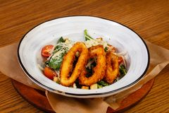 Salad with squid rings. And vegetables stock photos