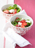 Salad with srawberries and mozzarella in bowls Royalty Free Stock Photo