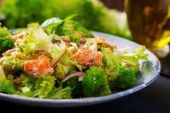 Salad of stewed fish salmon, broccoli, lettuce and dressing. Fish menu. Dietary menu. Seafood - salmon Royalty Free Stock Photos