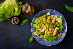 Salad of stewed fish salmon, broccoli, lettuce and dressing. Fish menu. Dietary menu. Seafood - salmon. Top view Stock Images
