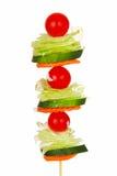 Salad on a stick. Vegetables on a skewer making a salad on a stick with salad dressing Stock Images