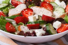 Salad of strawberries, cheese, chicken and vegetables macro. Horizontal Royalty Free Stock Photography