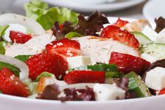 Salad of strawberries, feta cheese, vegetables and chicken Royalty Free Stock Photo
