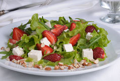 Salad with strawberries stock photography