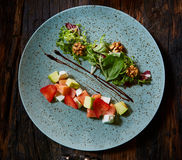 Salad with strawberries, salmon, cheese and walnuts Stock Photos