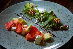 Salad with strawberries, salmon, cheese and walnuts Royalty Free Stock Photos
