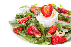 Salad with strawberry. Arugula and cheese.White background Stock Photo