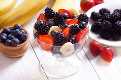 Salad strawberry banana blueberries and blackberries Royalty Free Stock Image