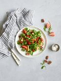 Salad with strawberry, cheese and nuts stock photography