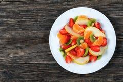 Salad of strawberry, kiwi fruit and pear Royalty Free Stock Photos