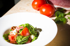 Salad with strawberry, prosciutto, herbs, cottage Stock Images