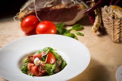 Salad with strawberry, prosciutto, herbs, cottage Stock Photos