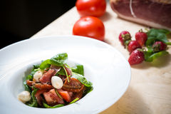 Salad with strawberry, prosciutto, herbs, cottage Royalty Free Stock Photo