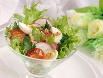 Salad of summer vegetables with quail eggs Royalty Free Stock Photo