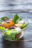Salad with sun-dried tomatoes Royalty Free Stock Image
