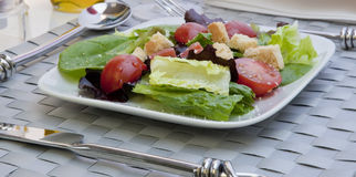 Salad with table setting Stock Photo