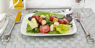 Salad with table setting Royalty Free Stock Images