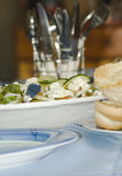 Salad table setting. Table setting with salad and bread rolls Royalty Free Stock Photo