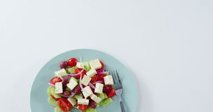 Salad with text in plate. Overhead view of salad with text in plate stock footage