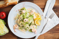 Salad with tiger prawns, parmesan and cream Stock Images