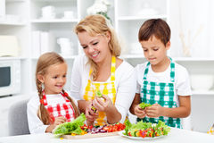 Salad time with the kids Royalty Free Stock Images