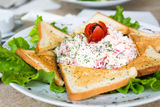 Salad with toasts. Salad with ham, vegetables and toasts Royalty Free Stock Photo