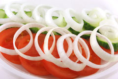 Salad with tomato. Cucumber and onion Royalty Free Stock Image