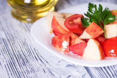 Salad tomato and apples. Vegan diet. Royalty Free Stock Images