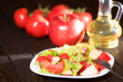 Salad tomato and apples. Vegan diet. Stock Photography