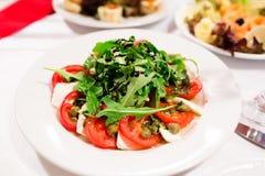 Salad with tomato, arugula and balsamic sauce Royalty Free Stock Photos