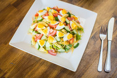 Salad with tomato and cucumber and egg Royalty Free Stock Images