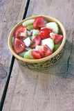 Salad of tomato,cucumber,onion in ceramic bowl Royalty Free Stock Photography