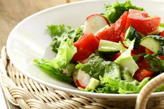 salad with tomato cucumbers and radishes Stock Photos