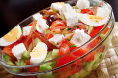 Salad with tomato, eggs, cucumbers and cheese Royalty Free Stock Photography