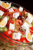 Salad with tomato, eggs, cucumbers and cheese Stock Images