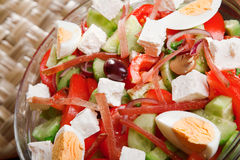Salad with tomato, eggs, cucumbers and cheese Royalty Free Stock Images