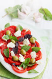 Salad with tomato goat cheese and olives Stock Photos