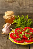 Salad of tomato, mint and garlic with honey dressing Stock Photos