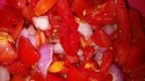 Salad. Tomato and onion salad with lemonjuice and red chilli Royalty Free Stock Photos