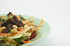 Salad with tomato raisins mango and nut. Healthy Salad consists apple carrots mango raisins nut and tomatoes Stock Photo