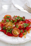 Salad with tomato, red pepper and capers Royalty Free Stock Image